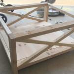 Frame, with bottom shelf installed and decorative x braces.