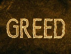 greed-title-still-small